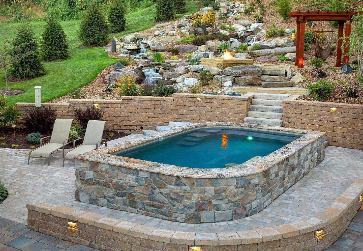 Custom Pool with Large Pondless Waterfall patio and fire pit
