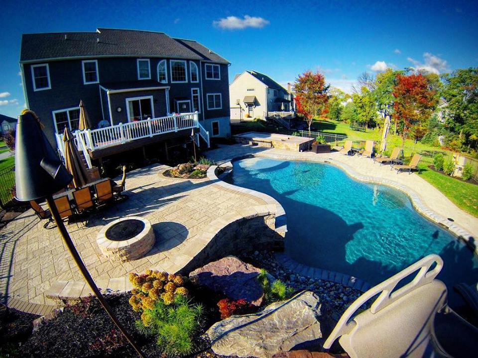 Backyard pool and outdoor dining area