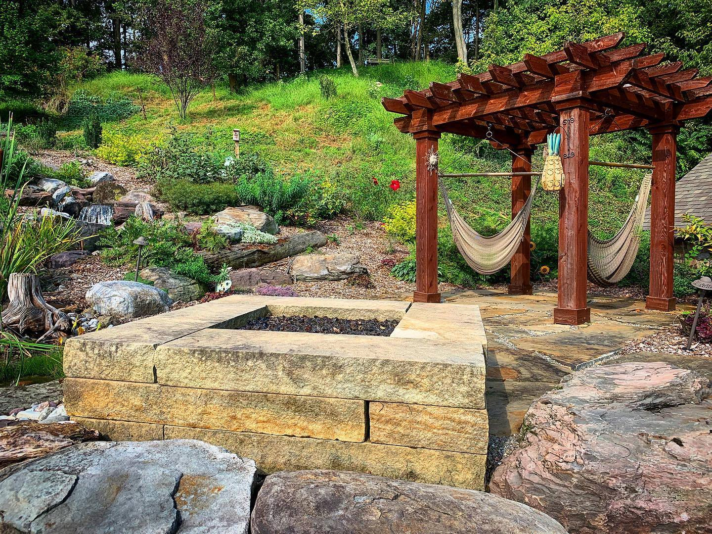 pergola and stone fire pit